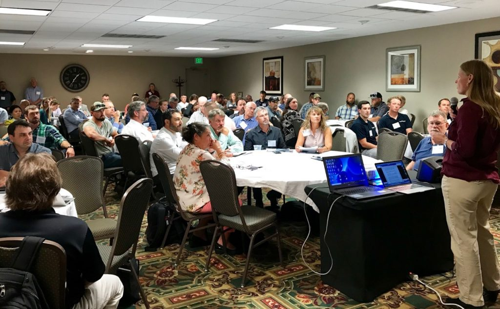 Newly elected USTFA president Katie Harris welcomes delegates to the United States Trout Farmers Association Fall Conference in Seattle, WA. (Credit: Liza Mayer)