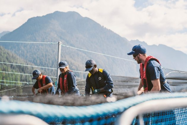 "Cermaq Canada employees securing net at BC site. 'People talk a lot about equipment and feed and technology, but we're farmers and a huge element of this business are the people,"" said David Kiemele, managing director, Cermaq Canada"